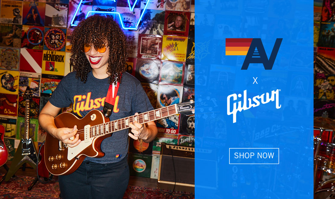 Gibson Artist, Jackie Venson, plays a gold-top Les Paul Classic with P-90's in front of a wall covered in old vinyl album covers, wearing one of Gibson's brand new tees made in collaboration with Aviator Nation. A part of the all-new Aviator Nation by Gibson Collection. Click here to shop now.