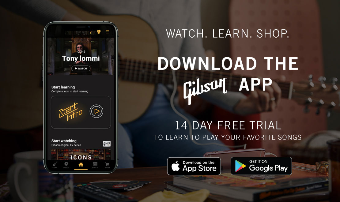 An iPhone is displayed, showcasing the home screen of the all new Gibson App. Watch Gibson TV. Learn to Play your favorite songs. Shop the world's most iconic guitar brand. Download today on Android or iOS.