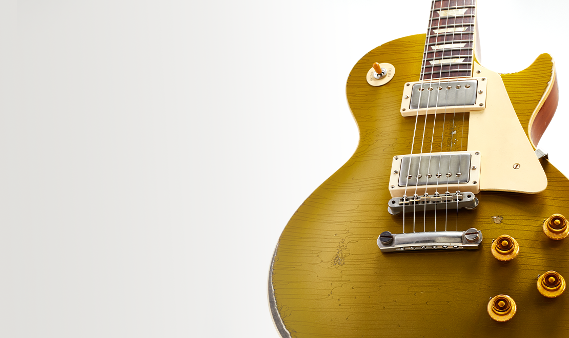 A close-up of a Gibson  Les Paul Goldtop Ultra Heavy Aged in Double Gold from the New Murphy Lab Collection, showing off the amazing craftsmanship coming out of the Gibson Custom Murphy Lab. Learn More about the Murphy Lab, or tap Shop Now to shop our latest collection.